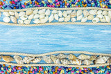 blue wooden rustic boards with seashells and rope. summer vacation background. top view - 200201802