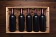 Wood case of red wine bottles