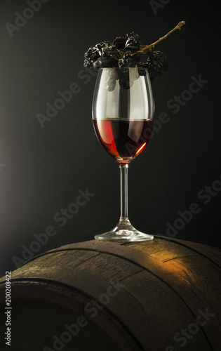 still life with red wine on old barrel