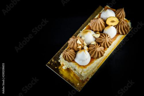 Foto op Plexiglas Kiev tasty piece of double layer Kiev cake with cream and nuts