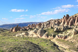 Amazing natural rock formations formed by volcanic activity and weathering in Cappadocia landscape, Turkey