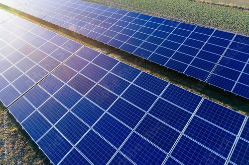Aerial drone view on solar panels on solar farm.