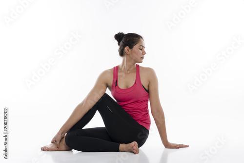 Foto Murales   Young woman doing yoga, India