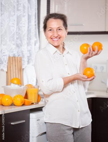 Fotobehang Sap smiling woman preparing orange juice