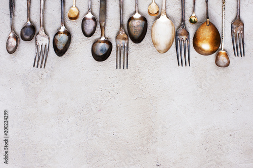 Background with vintage silverware on the grey table - 200224299