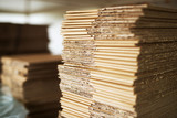 Close up picture of stacks of folded brown cardboard. - 200226284