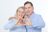 Closeup of couple making heart shape with hands. Selective focus. - 200228679