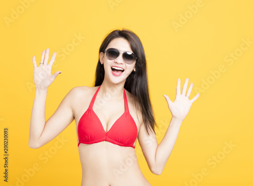 Foto Murales happy young woman in swimsuit isolated
