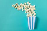 popcorn on color background - 200239244