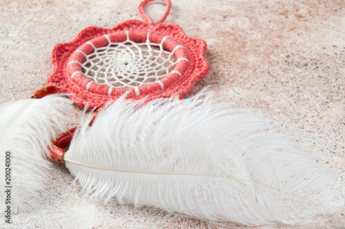 Coral dreamcatcher on concrete background