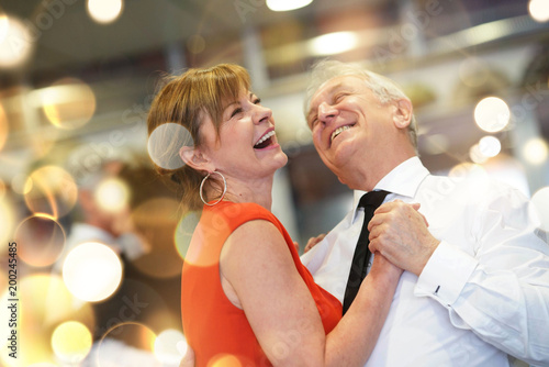 obraz lub plakat Romantic senior couple dancing together at dance hall