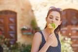 Woman eating a delicious pistachio ice cream