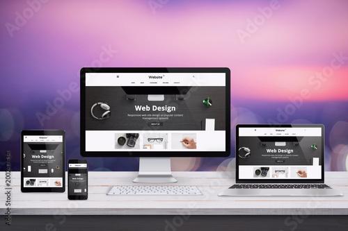 Responsive web site design presentation on computer, laptop, tablet and smart phone display.