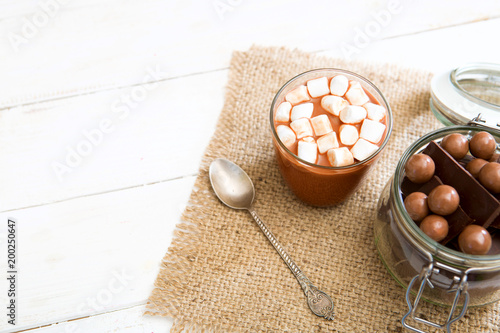 Foto op Aluminium Chocolade Chocolate milkshake with marshmallows on white wooden table