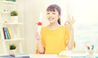 people, education, school, graduation and learning concept - happy asian young woman student with diploma scroll at home showing ok hand sign