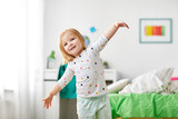 childhood and people concept - happy little girl having fun at home - 200256098