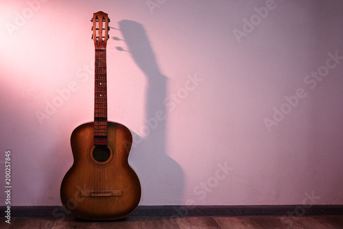 Old guitar in empty room