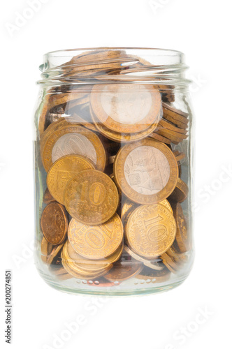Glass jar with ruble coins isolated on white background