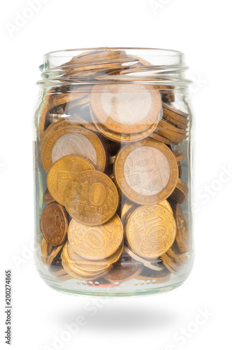 Russian ruble coins in glass jar on white background