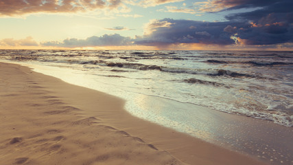 Beatiful sunset with clouds over sea and beach © Voyagerix