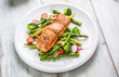 Roasted salmon steak with asparagos broccoli carrot tomatoes radish green beans and peas. Fish meal with fresh vegetable - 200294884