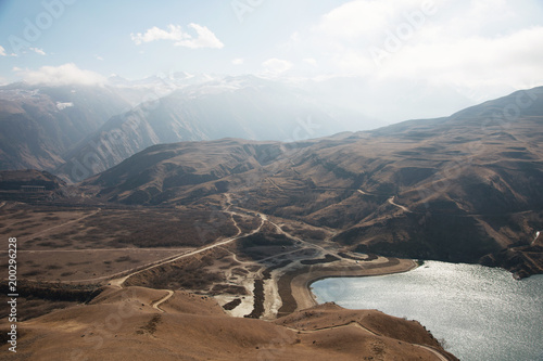 Foto op Aluminium Bergen Landscape mountain lake. Natural high reservoir with epic rocks in the background. North Caucasus. Russia. Bylhum village