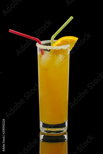 Fotobehang Sap Orange juice in a high glass isolated on a black background