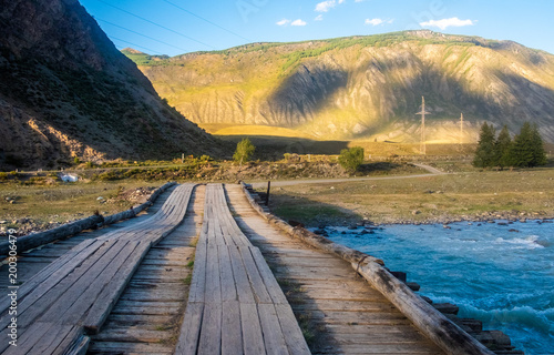 Fotobehang Natuur Mountain landscape. The automobile bridge across the Chuya River in the Altai Republic.