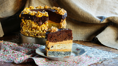 chocolate, walnuts and poppy seeds cake with butter cream