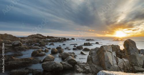 Fotobehang Zee zonsondergang Coast