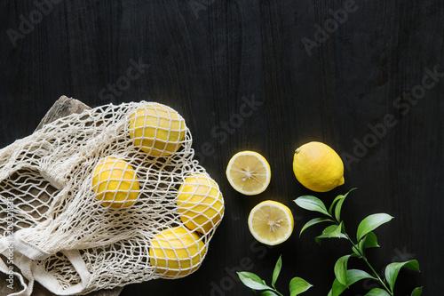 Fresh yellow lemons on black background - 200321833