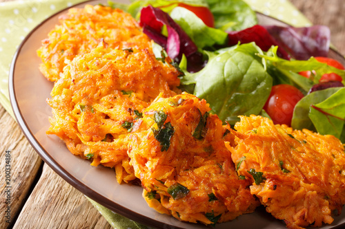 Healthy food: delicious sweet potato pancakes and fresh salad closeup. horizontal - 200334884