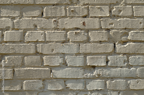 Foto op Plexiglas Baksteen muur Gemauerte Ziegelsteine mit Schatten in den Fugen