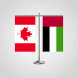 Table stand with flags of Canada and United Arab Emirates.Two flag. Flag pole. Symbolizing the cooperation between the two countries. Table flags
