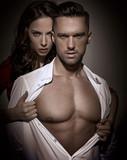 Pretty lady seducing a handsome busineesman - 200338084