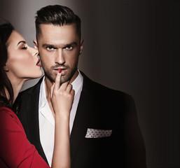 Sensual elegant woman seducing a handsome man