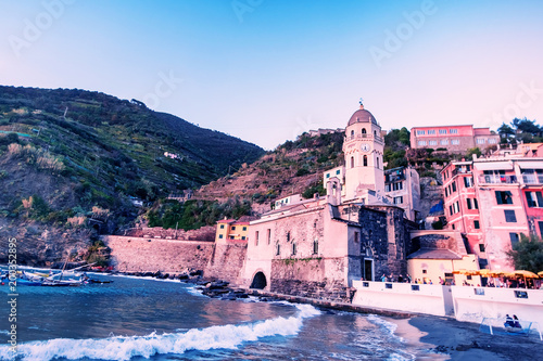 Plexiglas Liguria Scenic view of the summer Vernazza - one of five famous villages of Cinque Terre National Park in Liguria, Italy, suspended between Ligurian sea and land on sheer cliffs