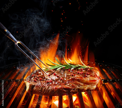 Plexiglas Steakhouse Entrecote Beef Steak On Grill With Rosemary Pepper And Salt