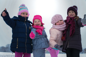 Portrait of little girls at winter season.
