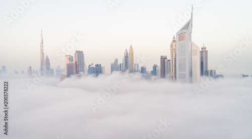 Foto op Plexiglas Dubai Aerial view of Dubai's skyscrapers in the clouds.