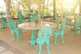Interior of tiffany. Beautiful summer cafe in tiffany colors. Forged iron chairs with a pattern and ornament, round marble tables - 200384476