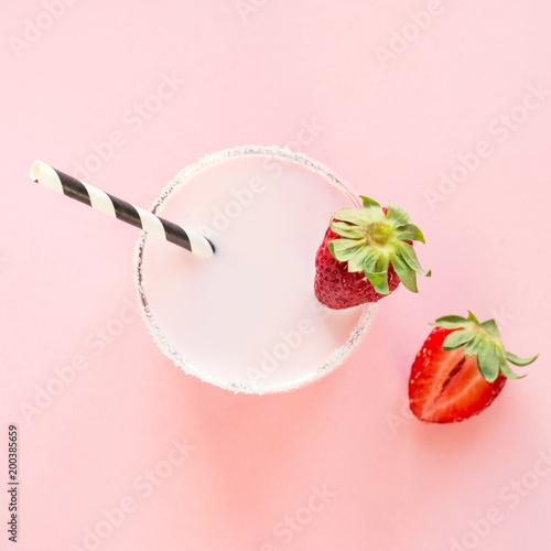 Fotobehang Milkshake Strawberry milkshake with berry on pink. Close up. Summer drink.