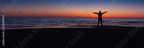 Foto op Plexiglas Zwart boy on the beach