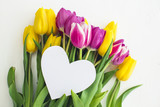 Greeting card - Pink and yellow tulips on a white background - 200389478