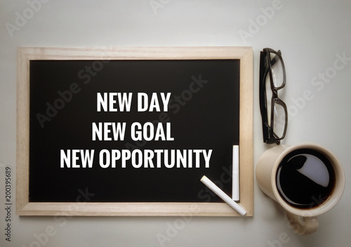 Motivational and inspirational quotes - New day, new goal, new opportunity . With vintage styled background.