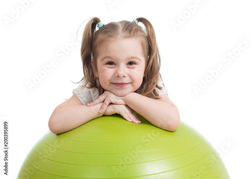 Happy sportive child playing with fitness ball isolated on white background - 200395899