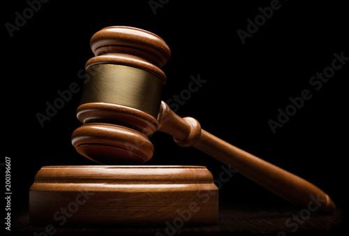 Wooden gavel on black background