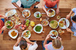 eating and leisure concept - group of people having dinner at table with food - 200412446