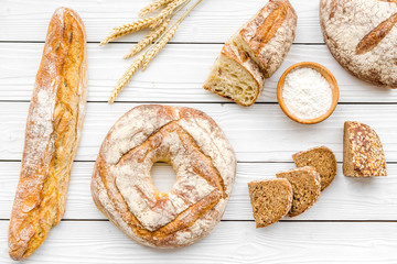 Bread shop. Baker's shop. Assorted bread on white wooden background top view