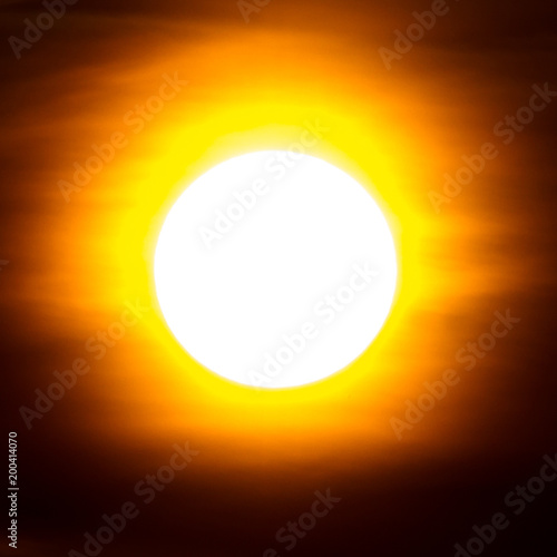 A large bright sun with rays in the sky